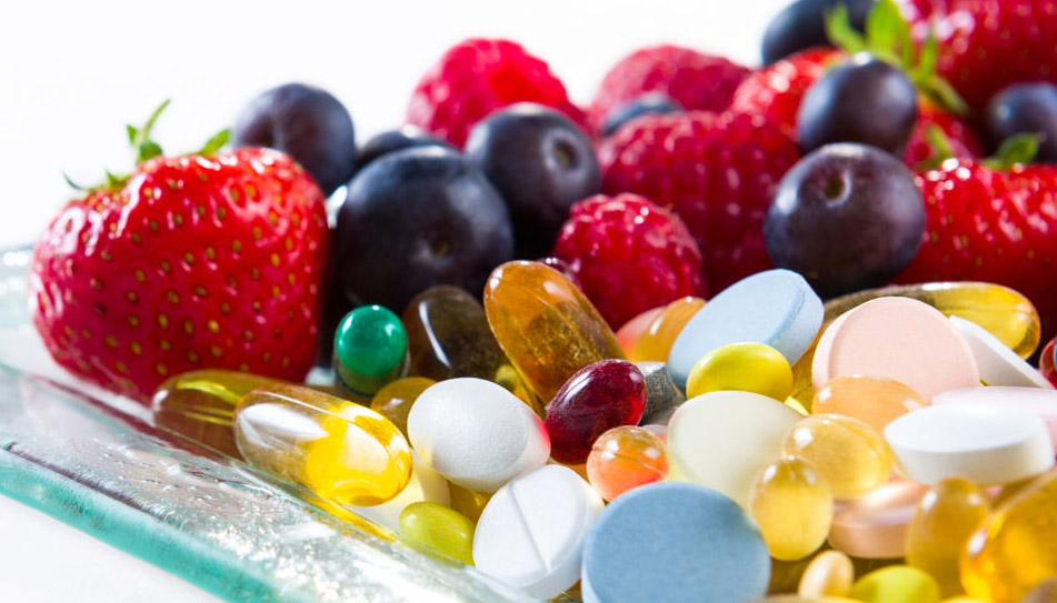 Healthy lifestyle, diet concept, Fruit and pills, vitamin supplements with copy space on white background